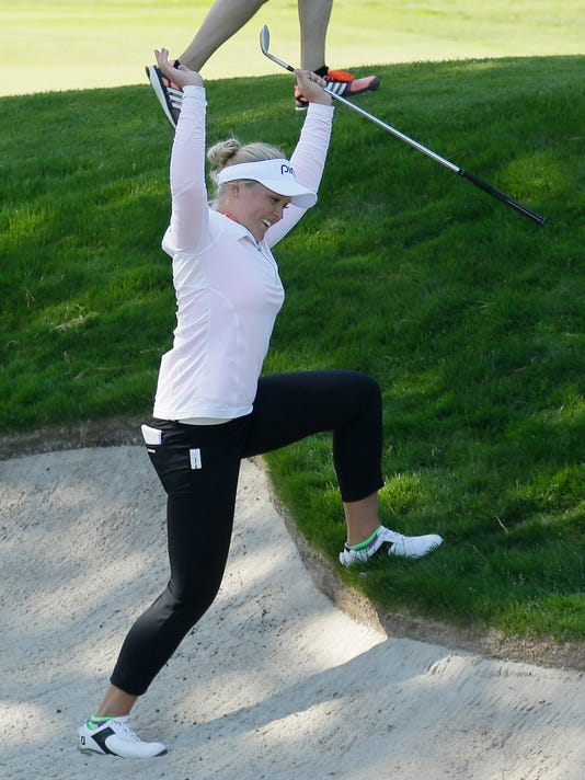 Brooke Henderson, of Canada, reacts after hitting the ball out of a bunker onto the 14th green during the final round of the Swinging Skirts LPGA Classic golf tournament Sunday, April 26, 2015, in Daly City, Calif. (AP Photo/Eric Risberg)