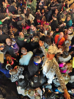 Stilt walker Jeff Fahringer of Tobyhanna, Pa., used his 9.5 feet of height to see over the large crowd. At 8 p.m. sharp, the balloons were released to the kids and their parents below on New Year's Eve at the York Central Market. (Bil Bowden - The York Dispatch)