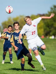 Annville-Cleona's Benjamin Rita heads the ball on as