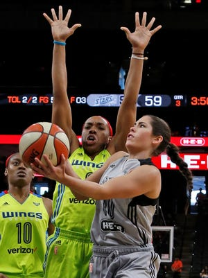 Dallas Wings forward Kayla Thornton tries to block a San Antonio Stars player's shot in May 2017 at the AT&T Center in San Antonio. Thornton used to play for Irvin High School and UTEP.