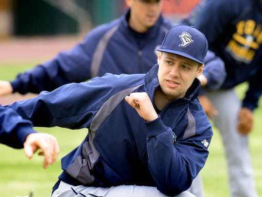 Revolution pitcher Eric Thomas stretches during the