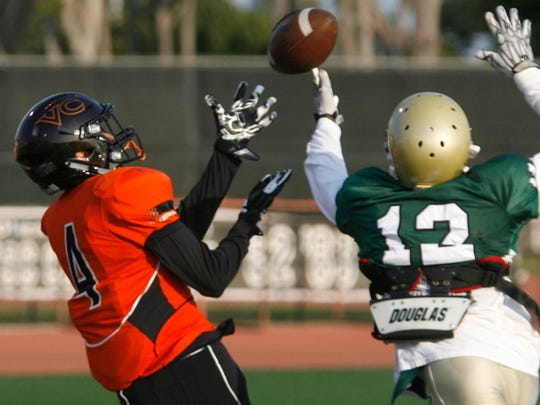 Ventura College wide receiver Cam Taylor (left) reaches for a pass during a scrimmage against L.A. Valley College.