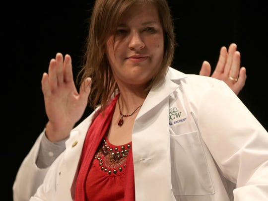 Michelle Raabe is coated during the Medical College of Wisconsin Central Wisconsin White Coat Ceremony at UW Marathon County, in Wausau, Wisconsin, July 7, 2016.