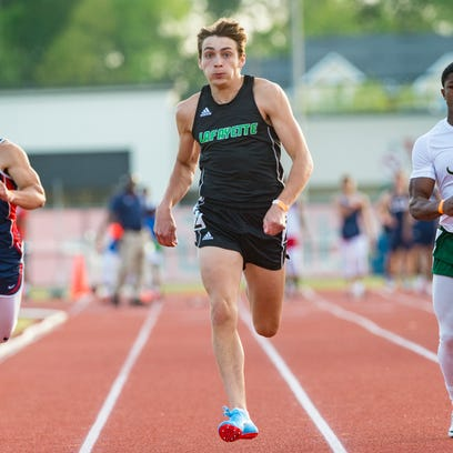 Armand Duplantis wins the boys 100 meter dash at the