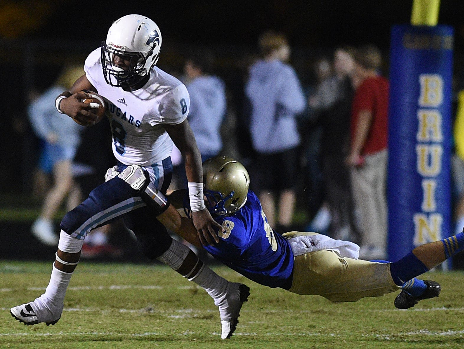 Centennial running back Mondu Sawyers (8) runs as Brentwood's Spencer Schwartz (8) tries to tackle him during a game at Brentwood on Friday.