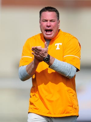 Head Coach Butch Jones calls during Tennessee Volunteers football practice at Anderson Training Facility in Knoxville, Tennessee on Thursday, March 23, 2017.