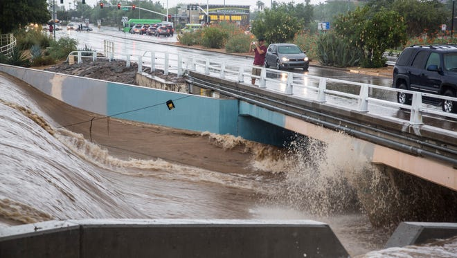 The Indian School crossing of the Indian Bend Wash during the flooding in Scottsdale, Monday, Sept. 8, 2014.