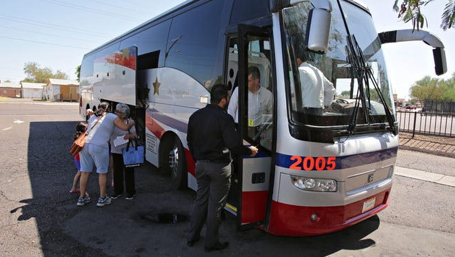 A TAP Royal international bus loads passengers at the company's current terminal at 2829 W. McDowell Road in west Phoenix, prior to a 27 hour journey to Guadalajara Mexico as seen in Phoenix on July 7, 2015.