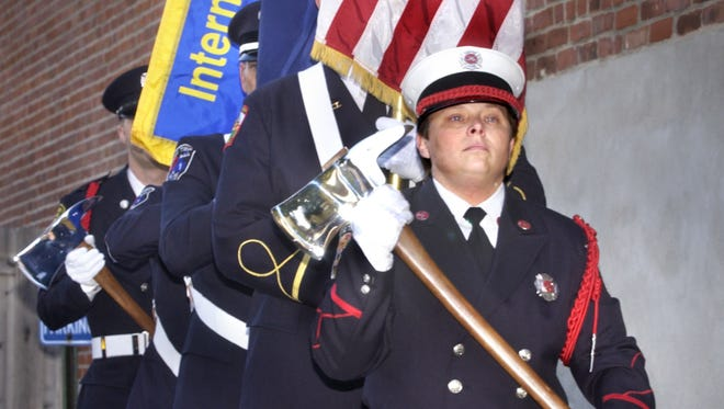 Honor guard presenting the colors at the 7th annual Reading of the Names memorial service on Wednesday, Oct. 1, 2003.