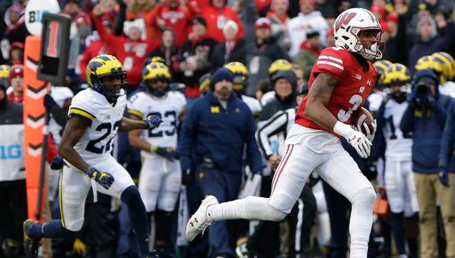 Redshirt freshman receiver Kendric Pryor scampers 32 yards for a Wisconsin touchdown on an end-around play against Michigan on Saturday at Camp Randall Stadium. Pryor got key blocks from center Tyler Biadasz, who was questionable to play early last week, and Beau Benzschawel on the play.