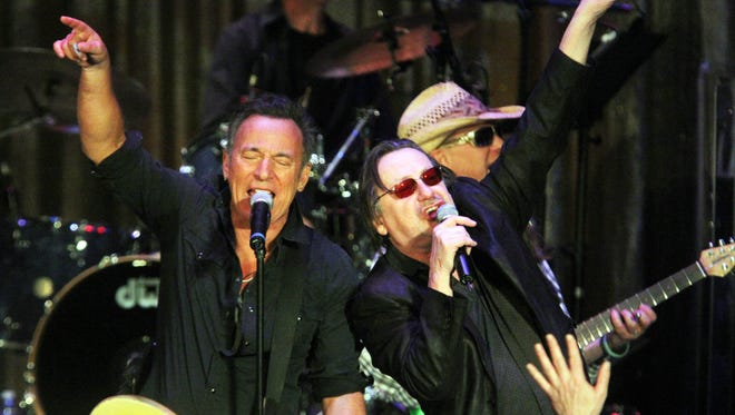 Bruce Springsteen joins Southside Johnny and others on stage at the Paramount Theater in Asbury Park during this year's Light of Day festival.