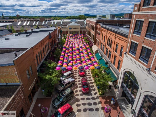 Colorful umbrellas hang above Third Street in downtown