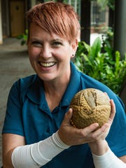 Erin Gray, the Animal Ambassador Lead Keeper, holds Pele, a three-banded armadillo, at the Nashville Zoo on October 11, 2017.