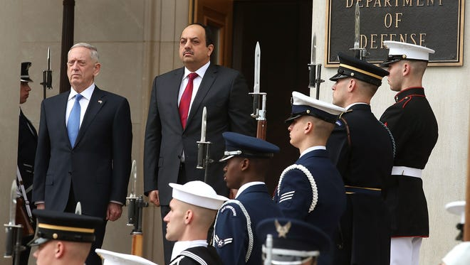 Defense Secretary Jim Mattis and Qatar's minister of defense, Khalid bin Mohammad al-Attiyah, in Arlington on March 27, 2017.