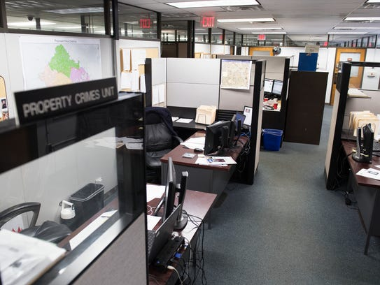 Cubicles fill the property crimes unit of the Greenville