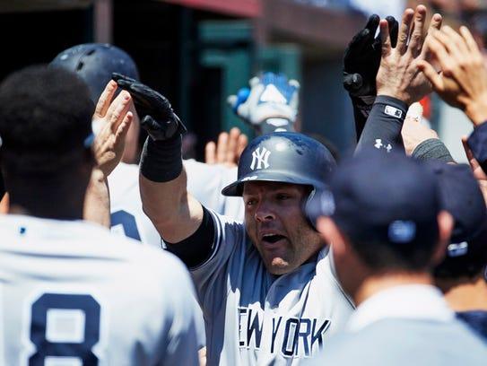 New York Yankees catcher Austin Romine (28) is congratulated