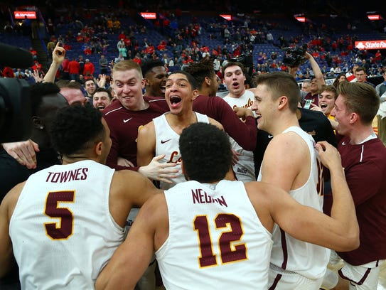 Loyola's Lucas Williamson (middle) leads the celebration with his teammates after beating Illinois State for the Missouri Valley Conference Basketball Tournament Championship at the Scottrade Center.