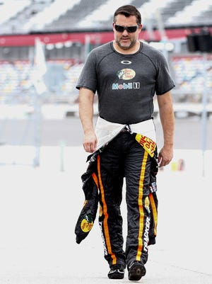 Three-time Sprint Cup champion Tony Stewart walks through the pits before practice for the Coke Zero 400 last month at Daytona International Speedway.