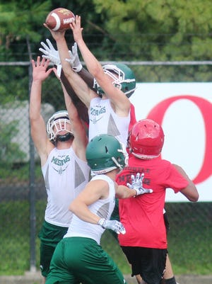 Brossart senior Bryce Donnelly skies to grab an interception during a football 7 on 7 competition July 19, 2017 at Newport Stadium. Competing teams were the host Wildcats, Bishop Brossart, Ludlow, Holy Cross and Dayton.