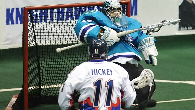 Rochester goalie Matt Vinc watches the ball drop into his basket during the season opener played at the Blue Cross Arena on Saturday, January 3, 2015. The Knighthawks started the night raising their third consecutive National Lacrosse League championship banner but lost this season's opener 13-12 to the Toronto Rock.