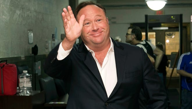 Alex Jones, a right-wing radio host and conspiracy theorist, is pictured arriving at a courthouse in Austin, Texas.