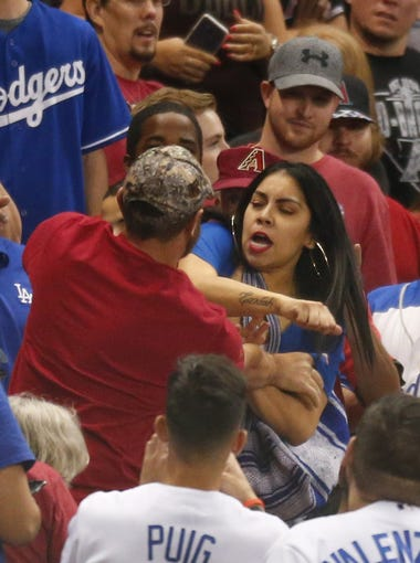 Arizona Diamondbacks and Los Angeles Dodgers fans get in a fight in right field during the ninth inning of game 3 of the NLDS at Chase Field in Phoenix, Ariz. October 9, 2017.
