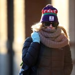 Morristown Patrolman B. LaFera tries to stay warm in single digit temperatures while directing traffic on the Morristown Green. Arctic air is causing much of the East to shiver during the first full week of January compared to the record setting high temperatures of last week, January 5, 2016, Morristown, NJ.