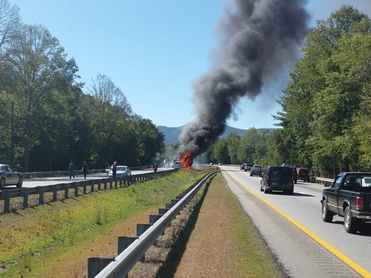 A tractor-trailer and a passenger van were fully engulfed in flames Tuesday, snarling traffic on I-40.
