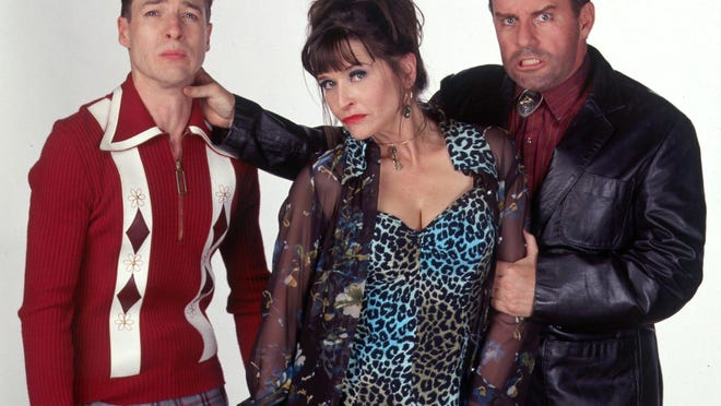 """Jan Hooks, pictured with French Steweart (left) and Phil Hartman, graduated from Cypress Lake High School in 1975. She played Vicki Dubcek in """"Third Rock From the Sun."""""""