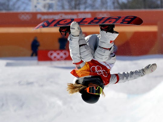 Chloe Kim, of the United States, jumps during the women's halfpipe finals at Phoenix Snow Park at the 2018 Winter Olympics in Pyeongchang, South Korea, Tuesday, Feb. 13, 2018. (AP Photo/Lee Jin-man)