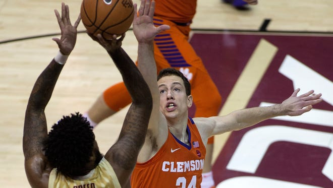 Clemson Tigers forward David Skara (24) defends Florida State Seminoles forward Phil Cofer (0) during the first half at Donald L. Tucker Center Wednesday night in Tallahassee, Fla.
