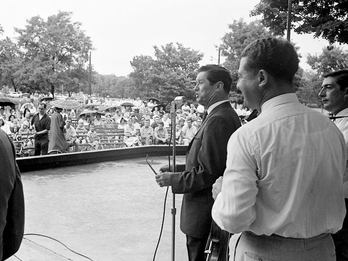 """About the only time we get to visit with you people in Nashville is when we come to the park to see you,"" Grand Ole Opry star Roy Acuff, center at mic, tells the audience at the start of The Nashville Tennessean's park concert in Centennial Park on July 12, 1964."
