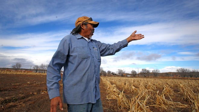Earl Yazzie talks about the effects of the Gold King Mine spill on his farm Dec. 23 in Shiprock. The Navajo Nation received $445,000 in reimbursements for costs associated with the response to the spill on Friday.