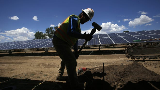 Juan Montoya an electrician with Mosher Enterprises Inc., installs a grounding rod on Monday at the city of Aztec's solar farm project site off Western Drive in Aztec. Juan Montoya an electrician with Mosher Enterprises Inc., installs a grounding rod on Monday at the city of Aztec's solar farm project site off Western Drive in Aztec.