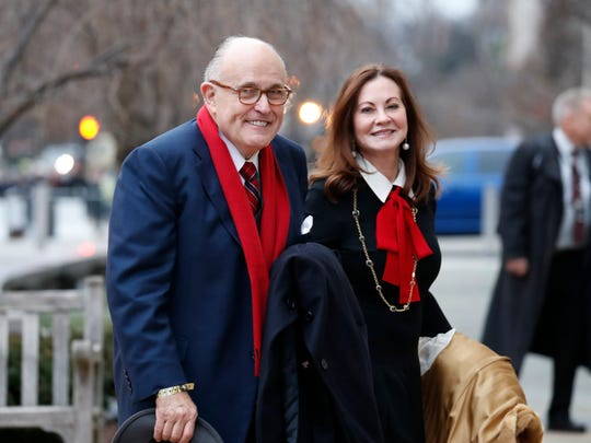 In a Friday, Jan. 20, 2017 file photo, Rudy Giuliani and his wife Judith Giuliani, arrives for a church service at St. John's Episcopal Church across from the White House in Washington.