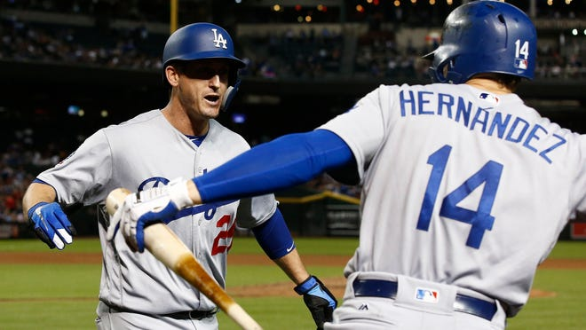 Los Angeles Dodgers' David Freese (25) celebrates his home run against the Arizona Diamondbacks with Enrique Hernandez (14) during the fifth inning of a baseball game, Monday, Sept. 24, 2018, in Phoenix. (AP Photo/Ross D. Franklin)