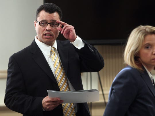 Andrew W. Pena with Elizabeth Martin, Morris County deputy assistant public defender before opening statements in Morris County Superior Court. Pena is representing himself on charges of sexually assaulting a woman outside a Butler bagel shop in 2007. Martin will act as stand-by counsel. October 27, 2015, Morristown, NJ.