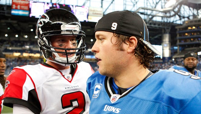 Matt Ryan and Matthew Stafford shake hands after the Lions-Falcons game at Ford Field in 2011.
