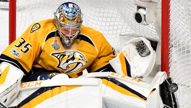 Nashville Predators goalie Pekka Rinne (35) deflects a Pittsburgh Penguins during the second period of game 4 in the Stanley Cup Final at Bridgestone Arena in Nashville, Tenn., Monday, June 5, 2017.