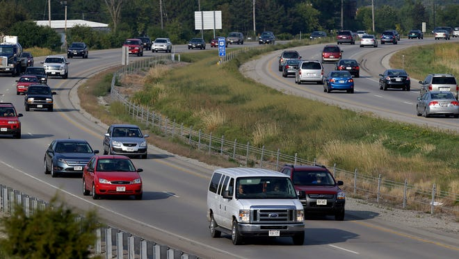 Traffic moves along Highway 41 near the Northland/OO exit in Grand Chute, Wis.