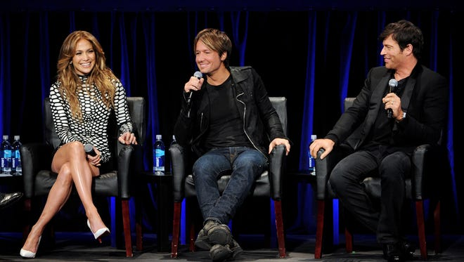 """Singers and current American Idol judges Jennifer Lopez, Keith Urban and Harry Connick Jr. appear onstage at the premiere of Fox's """"American Idol Xlll"""" at UCLA's Royce Hall on Jan. 14, 2014 in Los Angeles. Thursday's """"American Idol"""" episode reached its smallest audience since one week during its rookie season in the summer of 2002."""