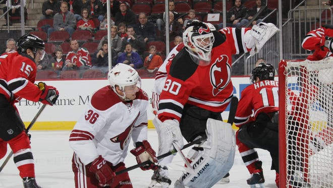 Rob Klinkhammer gets tangled with Martin Brodeur during the first period at the Prudential Center on March 27, 2014 in Newark, New Jersey.