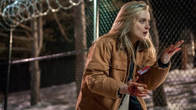 """Taylor Schilling is shown in a scene from """"Orange is the New Black."""" The second season of the prison series will be available on Friday on Netflix."""