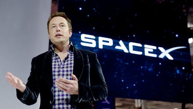 SpaceX CEO Elon Musk unveils the company's new manned spacecraft, The Dragon V2, during a news conference on May 29, 2014, in Hawthorne, California.