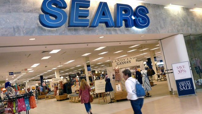 Shoppers walk into Sears in Peabody, Mass.