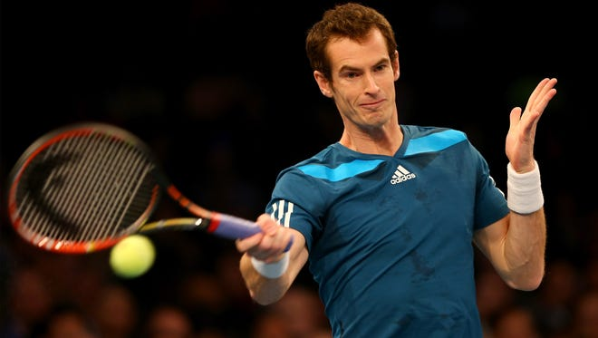 Andy Murray of Great Britain returns a shot to Novak Djokovic of Serbia during the BNP Paribas Showdown at Madison Square Garden.