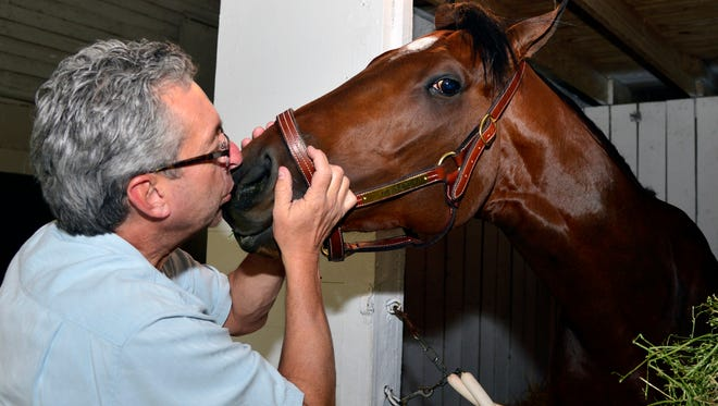 Trainer Gary Contessa with Uncle Sigh in Barn 41 at Churchill Downs. Uncle Sigh hails from Chip McEwen's Wounded Warrior Stables, will run in the 140th Kentucky Derb