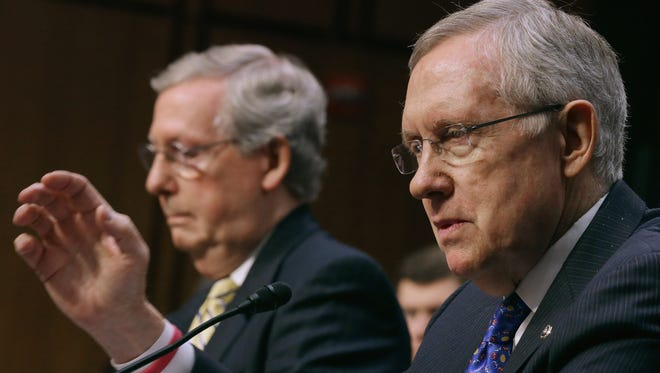 Senate Majority Leader Harry Reid, D-Nev., right, and Senate Minority Leader Mitch McConnell, R-Ky., testify before the Senate Judiciary Committee about political donations June 3 in Washington.