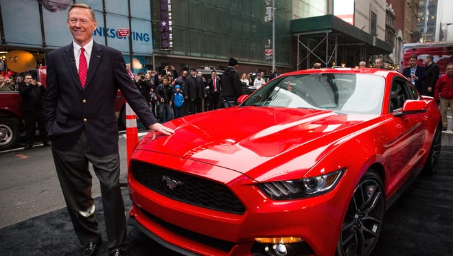 Alan Mulally, CEO of Ford, poses next to the 2015 Ford Mustang late last year.