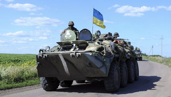 Military vehicles of the Ukrainian forces on the move on July 3, 2014.